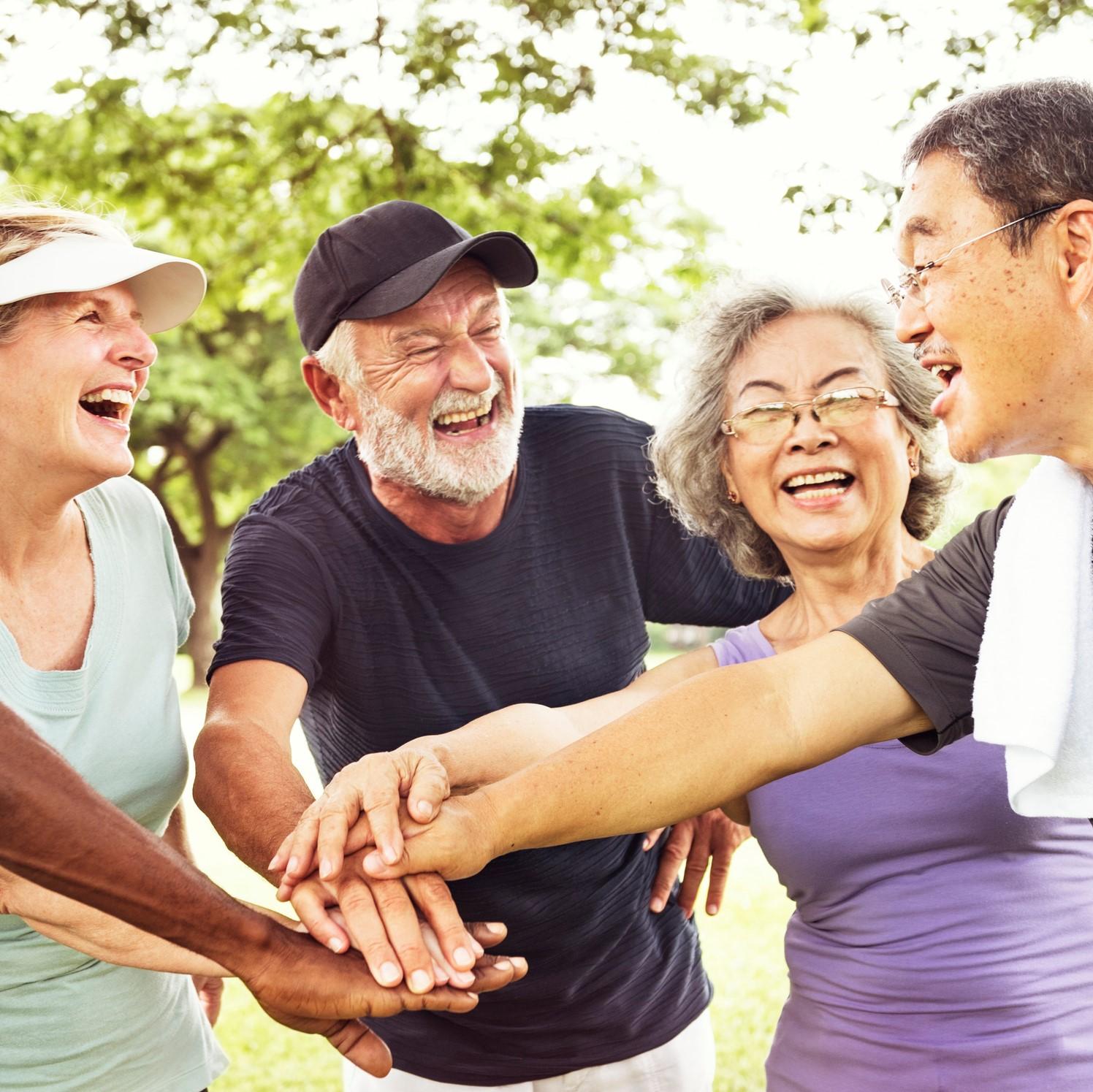Group of seniors smiling together. Togetherness concept.