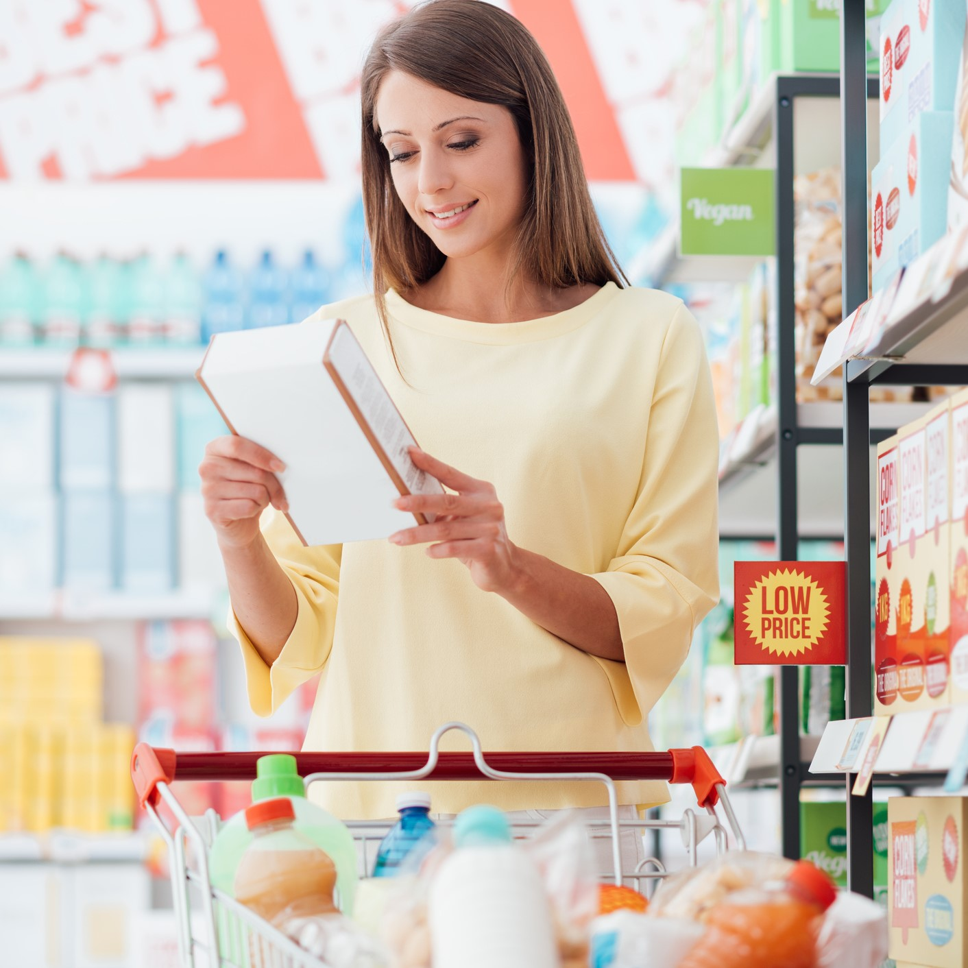 Woman reading food labels